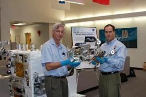 NASA Goddard RRM manager Justin Cassidy (right) and Ken Kremer manipulate RRM experiment tools.  Photo credit: Ken Kremer