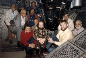 James Gunn (center), James Westphal (far right), and their team inside the Hale Telescope's Cassegrain cage with Four-Shooter, the prototype for the Hubble Space Telescope WFPC camera, c. 1984. (Credit: J. Gunn)