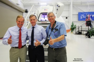 'Thumbs Up' for Boeing CST-100 space taxi at the Kennedy Space Center.  Florida's US Sen. Bill Nelson (left), final shuttle commander Chris Ferguson (now Director of Boeing's Crew and Mission Operations, center) and Ken Kremer pose in front of capsule with stairway leading to open hatch. Credit: Ken Kremer
