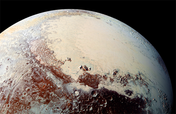 "A color image of Sputnik Planum, the region known as Pluto's ""heart,"" which is rich in nitrogen, carbon monoxide and methane ices. Credit NASA/Johns Hopkins Applied Physics Laboratory/Southwest Research Institute"