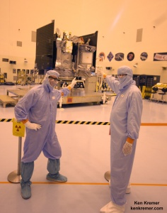Dr Dante Lauretta, principal investigator for OSIRIS-REx at the University of Arizona, Tucson, and Dr. Ken Kremer, Universe Today point to NASA's OSIRIS-REx asteroid sampling spacecraft inside the Payloads Hazardous Servicing Facility at the Kennedy Space Center on Aug. 20, 2016.  Credit: Ken Kremer/kenkremer.com