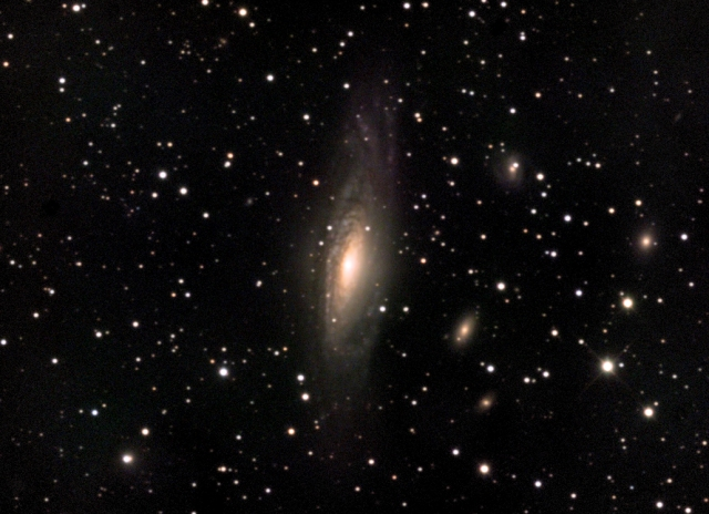 The spiral galaxy NGC-7331 in Pegasus, with other galaxies in the background.  CCD image taken in central NJ. (photo by R.A.Parker)