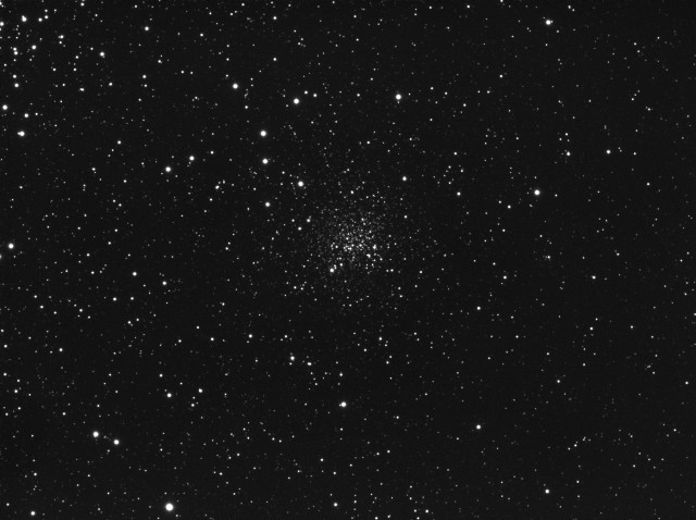 NGC2158, a distant open cluster near M35 (part of which is seen in the upper left corner)