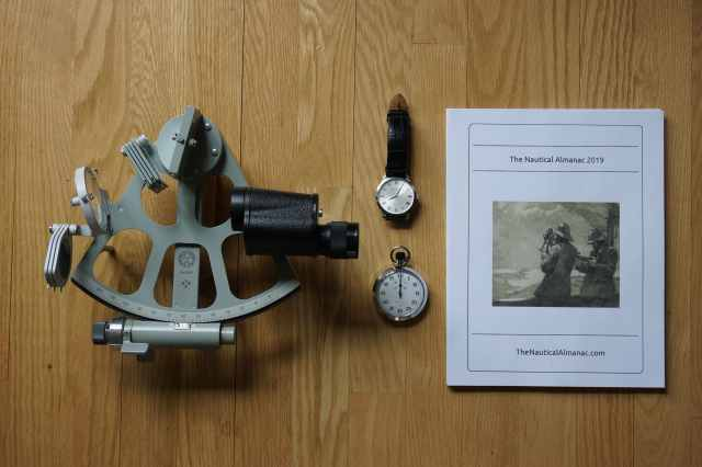 Sextant, timepieces, and Nautical Almanac.